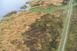 Aerial photography of Russian country side in rainy day. Autumn landscape. Famous Volga riverbank in Tver region. Concepts of travel and touristic mood, beauty of nature in bad wet weather. Top view