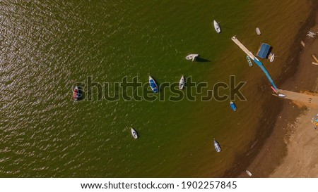 Aerial photography of the landscape on the dam of Valle de Bravo in Mexico, the sailboats are distinguished.   Foto stock ©