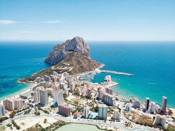 Aerial photography Penyal d'Ifac Natural Park, Calpe townscape turquoise bright Mediterranean Sea waters, residential buildings. Province of Alicante, Costa Blanca, Spain. Travel and landmark concept
