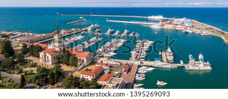 Aerial photography. The black sea coast of Russia, the city of Sochi, seaport, yachts and ships at the pier. City attraction