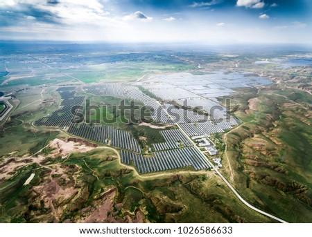 Aerial Photovoltaic panel scene in aerial green vegetation area Stockfoto ©