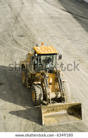 aerial pic of a bulldozer or front loader used in freeway or road construction.