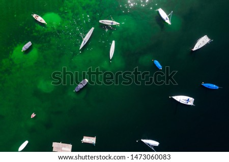 Aerial pic of still boats in a lake