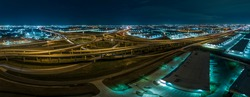 Aerial picture of highway intersection at night near Fort Worth in Texas with lightspurs