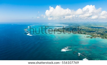 Aerial picture of the east coast of Mauritius Island. Beautiful lagoon of Mauritius Island shot from above. #556107769