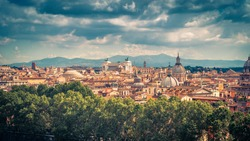 Aerial picturesque view of Rome, Italy. Cityscape of old Rome on a sunny day. Rome skyline in summer. Beautiful scenic panorama of Rome taken from above. Scenery of Roma city. Vintage style photo.