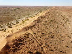 AERIAL Ridge line of Big Red, the most famous and largest sand dune in the Simpson Desert, Queensland, Australia.
