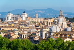 Aerial scenic view of Rome in summer, Italy. Rome is one of the main travel destinations in Europe. Beautiful Rome skyline. Panorama of historical area of Rome on a sunny day. Scenery of Roma city.
