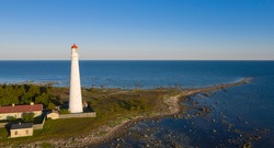Aerial scenic view to the spit on the top of northernmost part of Hiiumaa isl, Estonia with the historic lighthouse