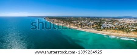 Aerial seascape, of Praia Porto de Mos (Beach and seaside cliff formations along coastline of Lagos city), famous destination in Algarve. South Portugal. Stock fotó ©