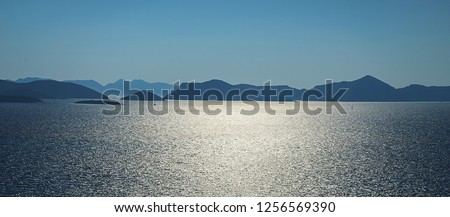 Aerial seascape view to turquoise waters of Adriatic Sea and islands in the distance, near town Dubrovnik in Croatia. Famous sailing travel destination in Croatia, Dubrovnik summer scenery in Europe.