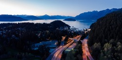 Aerial shot of a BC Ferry boat at the Horseshoe Bay ferry terminal just after sunset.