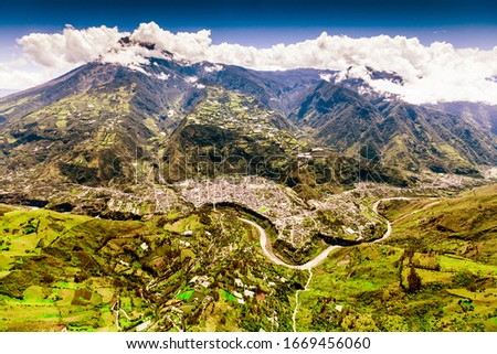 aerial shot of banos de agua santa nne to ssw tungurahua volcano in the background and pastaza river in foreground volcanoe vulcan building canyon vacation earth dynamic outdoor exploration ecuador ex Stock fotó ©