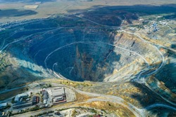 Aerial shot of big and deep mining quarry