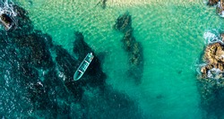 Aerial shot of boat on the coast of Michoacán, Mexico.
