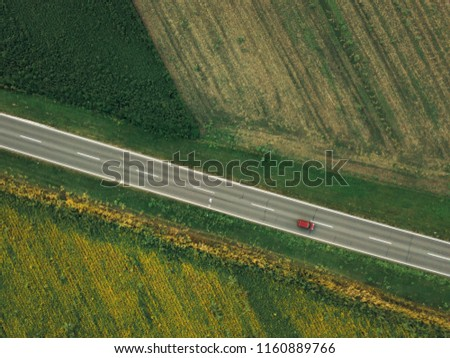 Aerial shot of car on the road from drone point of view