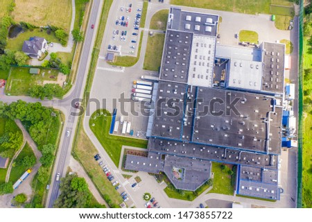 Aerial Shot of Industrial Warehouse Loading Dock where Many Truck with Semi Trailers Load Merchandise.  #1473855722