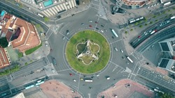 Aerial shot of Plaza de Espana in Barcelona, Spain. Roundabout city traffic, top view