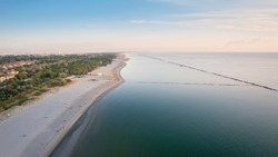 Aerial shot of sandy beach with umbrellas, typical adriatic shore.Summer vacation concept.Lido Adriano town,Adriatic coast, Emilia Romagna,Italy.
