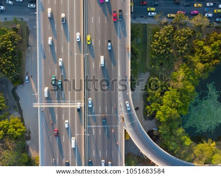 aerial shot of super highway traffic with cars and busy roads in day time