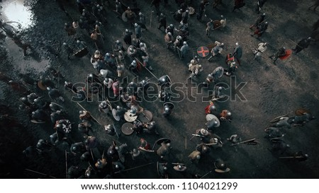 Aerial shot of the Battlefield where Armies of Medieval Warriors Fighting. Medieval Reenactment.
