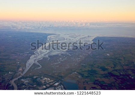 Aerial shot of the Dee estuary and the Wirral, England, UK, evening light. Сток-фото ©