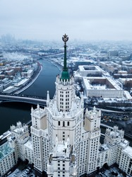 Aerial shot of the star of Stalins building - symbol of communism. On the background Moscow River, Moscow city and snowy houses in winter.