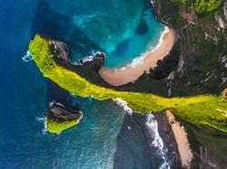 Aerial shot of the tropical coast of the island of Nusa Penida, beach of Kelingking, Indonesia