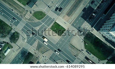 Aerial shot of urban road intersection on a sunny day, top view