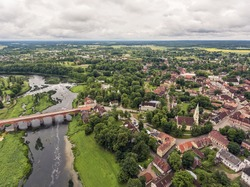 Aerial shot over Europe's widest waterfall Venta rapids in Kuldiga, Latvia during summer time.