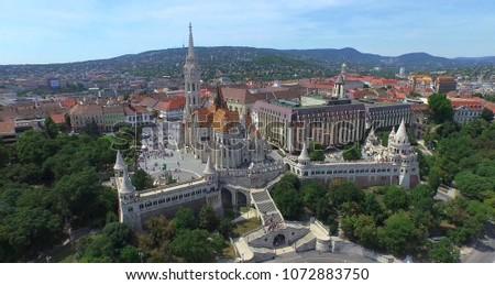 Aerial shot. The Matthias Church and the Fishermen's Bastion. Budapest, Hungary. #1072883750