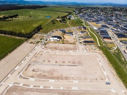 Aerial shots of a developing housing estate in the outer suburbs of Melbourne Australia, roads and gutters have been built, plots of land some already sold are almost ready for houses to be built.
