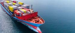 Aerial side view head of cargo ship carrying container and running  near international sea port for export.