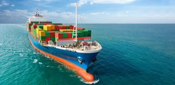 Aerial side view of smart cargo ship carrying container from custom container depot go to ocean concept freight shipping by ship service on blue sky background.