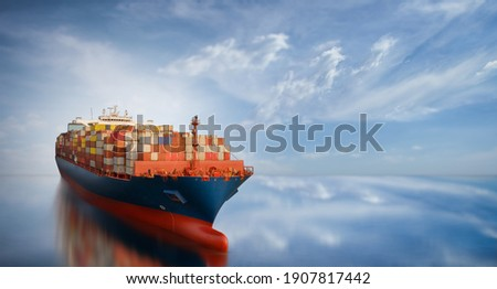 Aerial side view of smart cargo ship carrying container from custom container depot go to ocean concept freight shipping by ship service on blue sky background. Photo stock ©