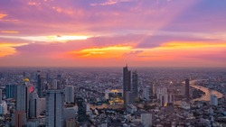 Aerial Skyline Panorama of Bangkok Cityscape from Mahanakorn Skywalk with Super Beautiful Twilight Peak at Sunset time. The New Observation Deck from The Tallest Building of Bangkok.