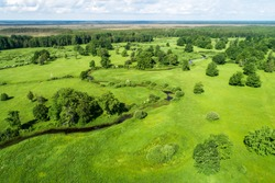 Aerial Soomaa National Park. Tõramaa wooded meadow during a summery sunny day in Estonian nature, Northern Europe.