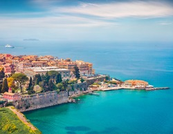 Aerial spring cityscape of capital of Corfu island. Colorful building  at the morning in Kerkira town. Amazing  seascape of Ionian Sea, Greece, Europe. Traveling concept background.