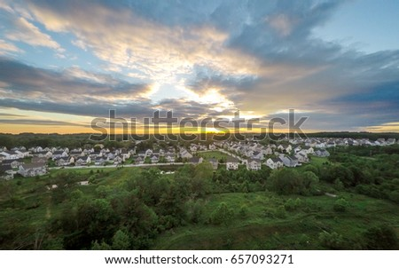 Aerial Suburban Neighborhood at Sunset #657093271