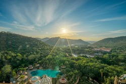 Aerial sunrise scene of suncity in South Africa with flare and ray from the sunrise