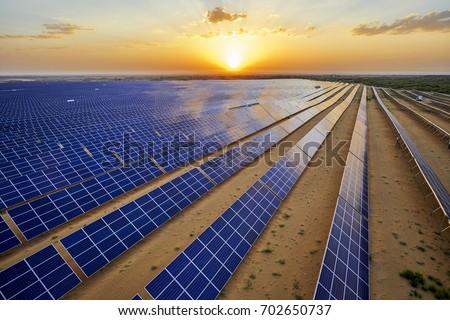 Aerial sunrise when the desert solar photovoltaic #702650737