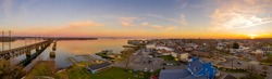 Aerial sunset panorama of Havre De Grace Harford County, Maryland, and the railroad bridge over the mouth of the Susquehanna River and the head of Chesapeake Bay one of the best American small towns