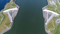 Aerial top down photo Maeslantkering storm surge barrier on the Nieuwe Waterweg Netherlands it closes if the city of Rotterdam is threatened by floods and is one of largest moving structures on earth