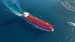 Aerial top down photo of industrial oil and fuel tanker ship cruising open ocean sea