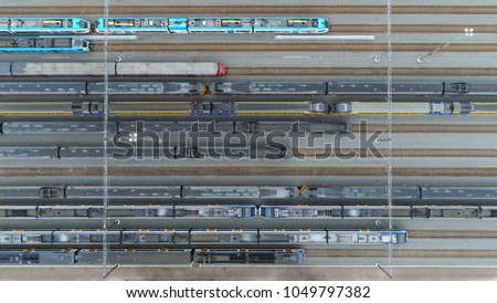 Aerial top down photo of railway transportation hub showing the different trains parked next to each other on the rails