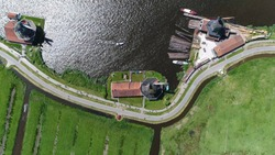 Aerial top down photo of windmills of Zaanse Schans one of most popular tourist attractions of the Netherlands and an anchor point of ERIH the European Route of Industrial Heritage