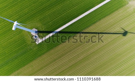 Aerial top down picture of wind turbine a device that converts the wind's kinetic energy into electrical energy providing renewable energy sustainable energy into the electricity grid