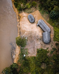 Aerial top down view of indigenous community in Amazon rainforest.