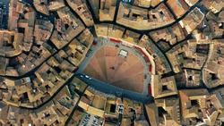 Aerial top down view of Siena cityscape involving famous Piazza del Campo or Campo Square. Tuscany, Italy