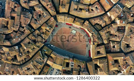 Aerial top down view of Siena cityscape involving famous Piazza del Campo or Campo Square. Tuscany, Italy #1286400322